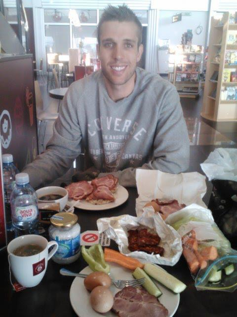 Hubby eating our breakfast spread of eggs, ham, veggies, and a dash of coconut oil in our tea/coffee at the Belgrade airport!